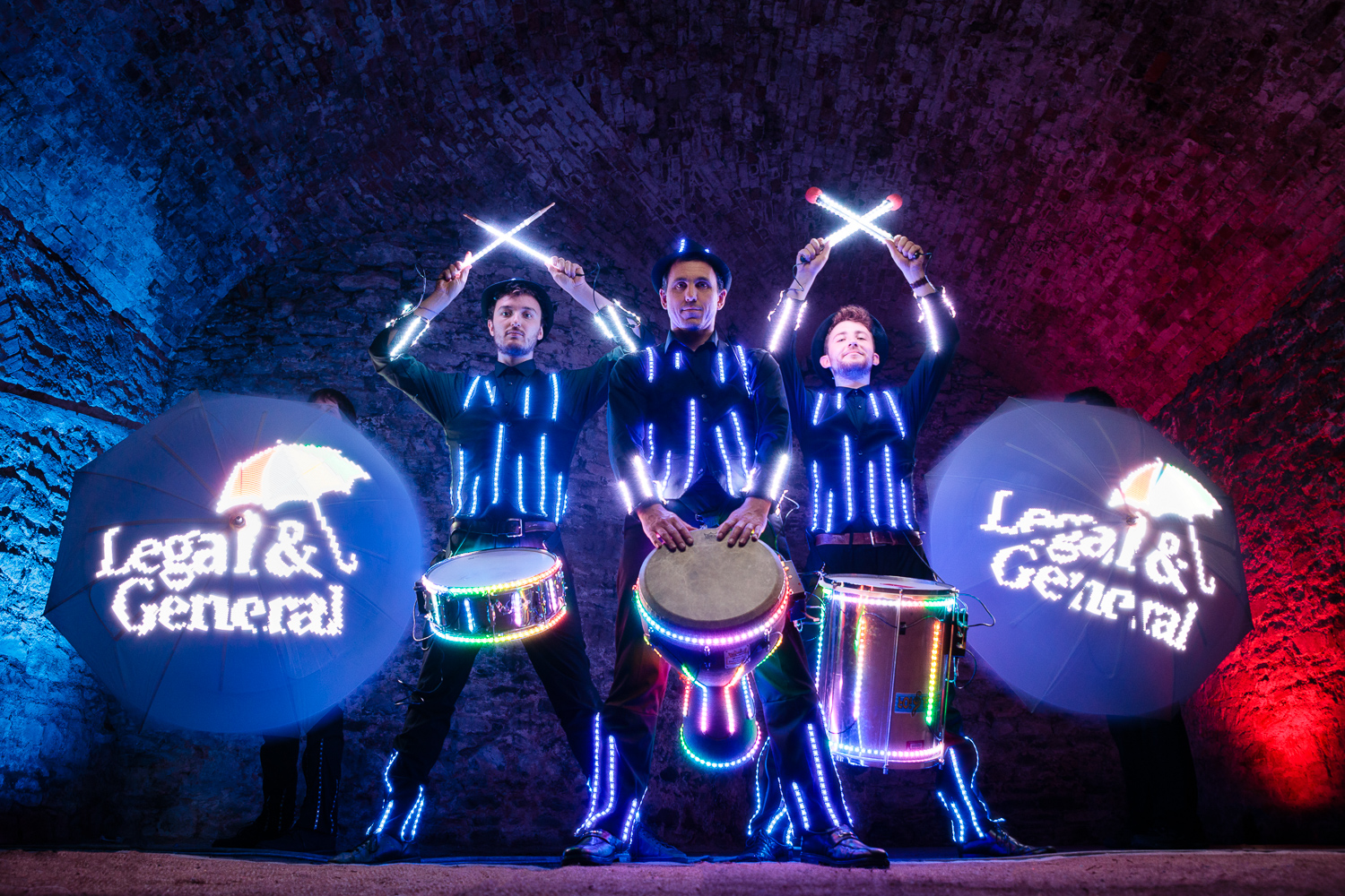 Glow Drummers and umbrellas Legal and General